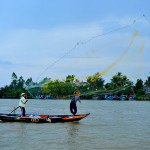 Casting the net for fishing on Thu Bon