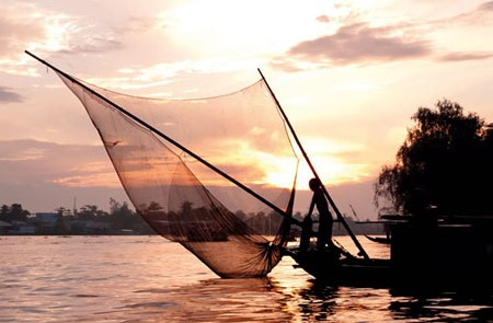 Fishing boat Mekong river Sunset